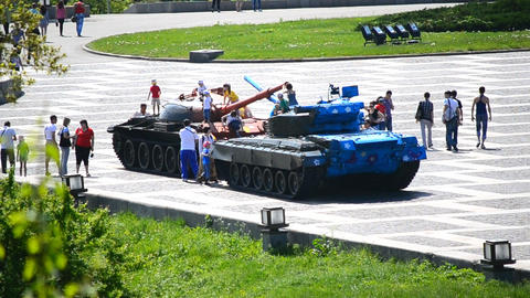 children play on a tank Live Action