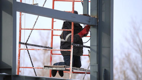 Welder operating at the height Footage