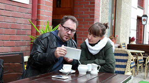 Man explains something to the woman on a tablet co Footage