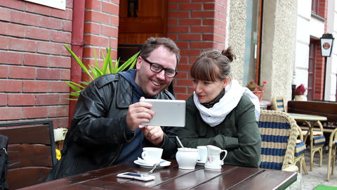 Man shows something to the woman on tablet compute Live Action