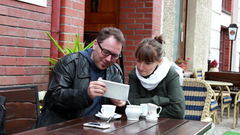 Couple viewing photos on a tablet computer Footage