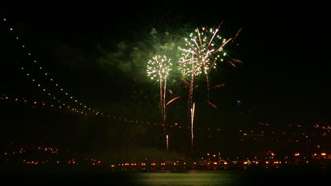 Firework at Night near Illuminated Bridge Footage