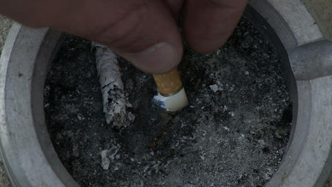 Hand Puts Out A Cigarette stock footage