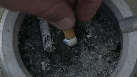 Hand puts out a cigarette Live Action