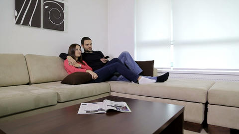 Young Couple Watching Television stock footage
