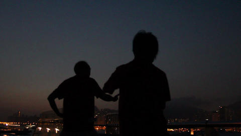 Silhouetted senior couple practising martial arts together, Hong Kong, China Footage