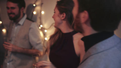 Young men and women dancing during Christmas party Live Action