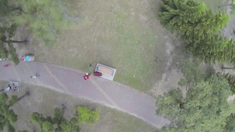 drone pilot landing drone at Daan park in slow mot Footage