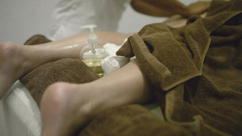 Stone massage of female legs at beauty spa Footage
