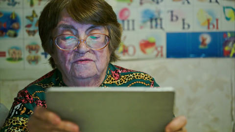 Senior Woman Using Touch Pad And Talking stock footage