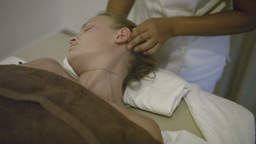Young woman getting head massage at spa Footage
