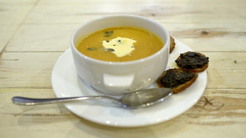 Serving of soup with bruschetta in cafe or restaur Live Action