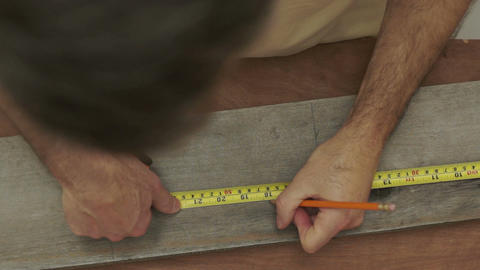 Carpenter Measuring Wood Overhead Close Up stock footage