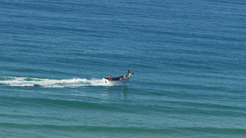 Fishing Boat Fast Floating on the Ocean Waves Footage