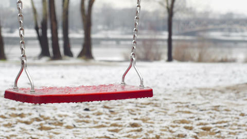Red empty swing during the winter Footage