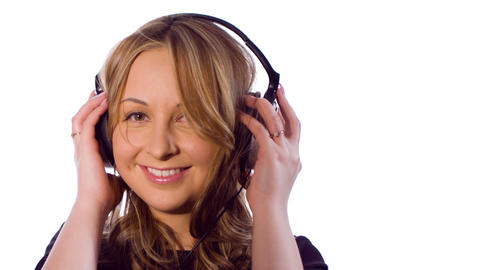 Happy young woman listening to music, white backgr Footage