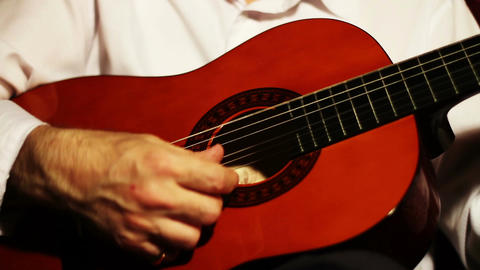 Musician and Acoustic Guitar 02 playing Stock Video Footage