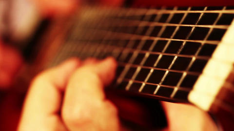 Musician and Acoustic Guitar 08 playing closeup change focus Stock Video Footage
