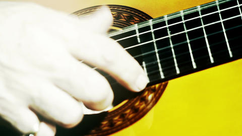 Musician and Acoustic Guitar 14 playing closeup stylized... Stock Video Footage