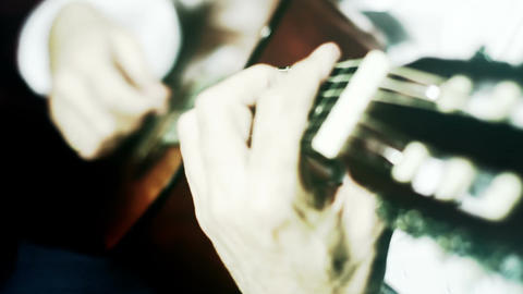 Musician and Acoustic Guitar 16 playing wide angle stylized artcolored Footage