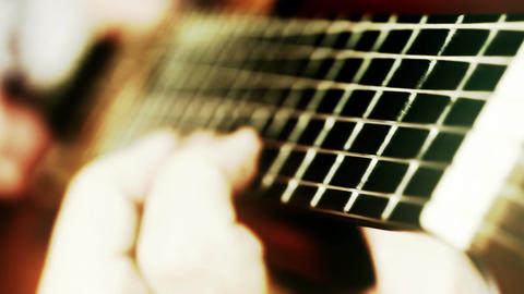 Musician and Acoustic Guitar 18 playing wide angle stylized artcolored Footage