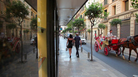 Street in Palma de Mallorca, horse cab and taxi Footage