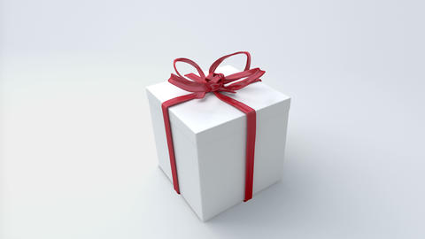 White Gift Box With Red Ribbon Closing. Tying Bows stock footage