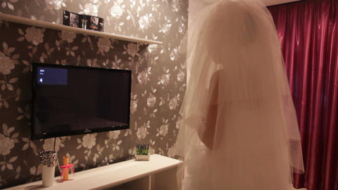 The bride watching TV Footage