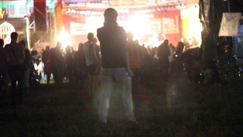 the guy at the rock concert in front of the scene Footage
