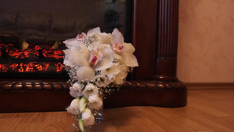 two wedding bouquet against the background fireplace (dolly) Footage
