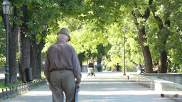 An old man walks along the street of Odessa Footage