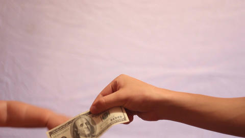 Baby Hand Takes Money stock footage