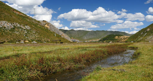 4k River On The Prairie,clouds Mass Rolling Over Mountains,far Away Temple stock footage