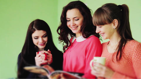 1731 Group of girls on a break reading a fashion m Footage