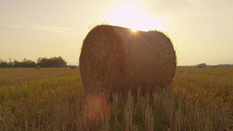 SLOW MOTION: Bales of hay at sunset Footage