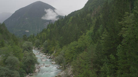 AERIAL: Crystal clear river running through mounta Footage