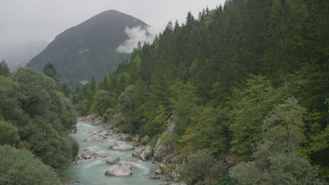 AERIAL: Blue river running through lush forest Footage