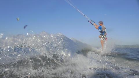 SLOW MOTION: Kiteboarder sprays water into camera  Footage