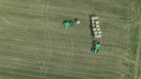 AERIAL: Loading bays of hay on a tractor Footage