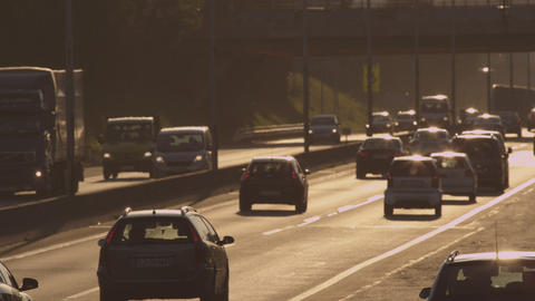 DEFOCUS: Heavy traffic on a motorway at sunset Footage