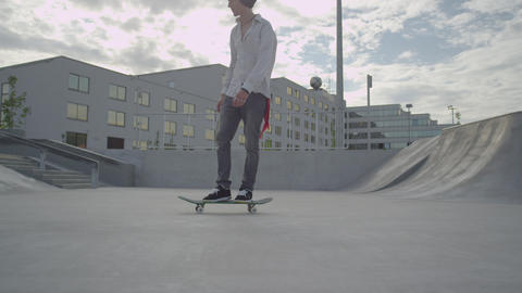 SLOW MOTION: Skateboarder Cruising In Skatepark stock footage
