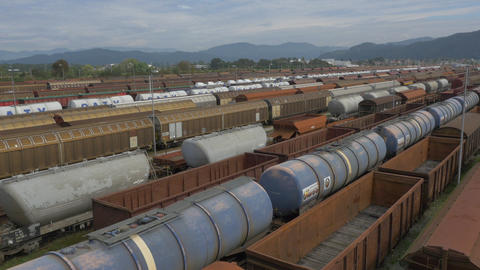AERIAL: Freight trains on a railroad station Live Action