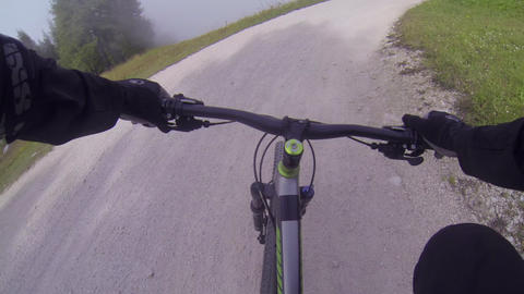 FIRST PERSON VIEW: Biker Riding On A Track stock footage
