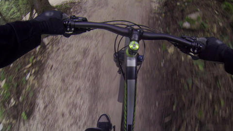 FIRST PERSON VIEW: Biker riding downhill Footage