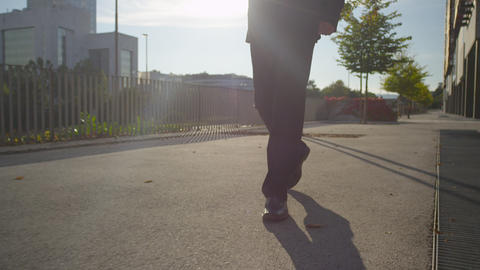 CLOSE UP: Man wearing a suit walking on the sidewa Footage