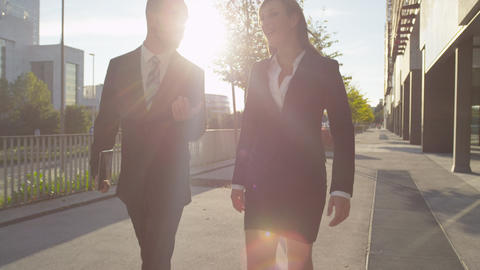 CLOSE UP: Young business couple walking to work an Footage