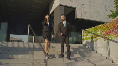 SLOW MOTION: Business people leaving work Footage