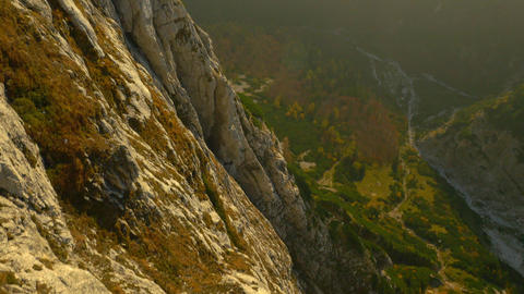 AERIAL: Huge rocky wall in the mountains Footage
