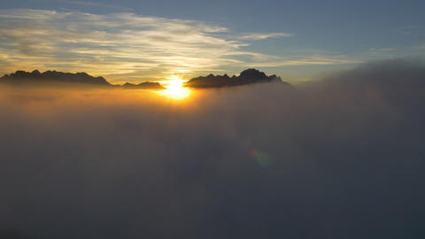 AERIAL: Beautiful golden sunset above the clouds Footage