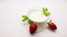 strawberry falling into cream Footage